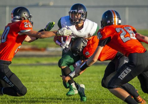 Jerome's Defense Holds Strong to Overcome Fumbles: Tigers Win at Minico
