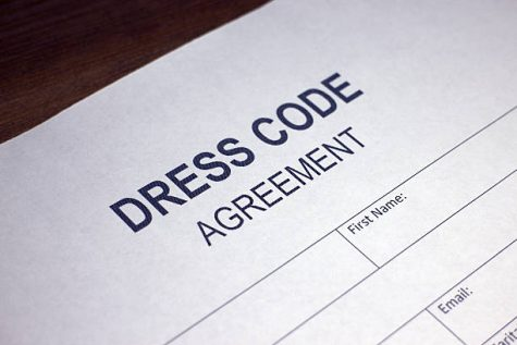 Someone filling out Dress Code Agreement.